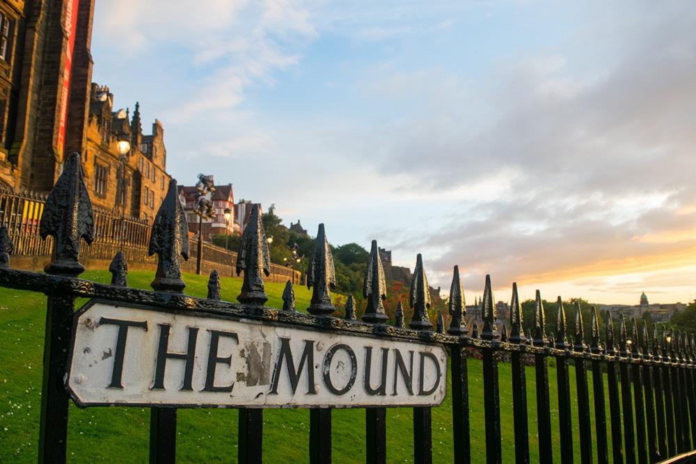 The Mound sign on railings in Edinburgh
