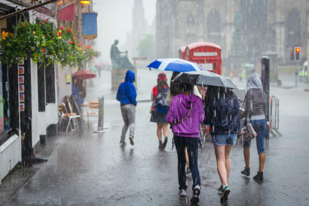 People with umbrellas in the rain in Edinburgh