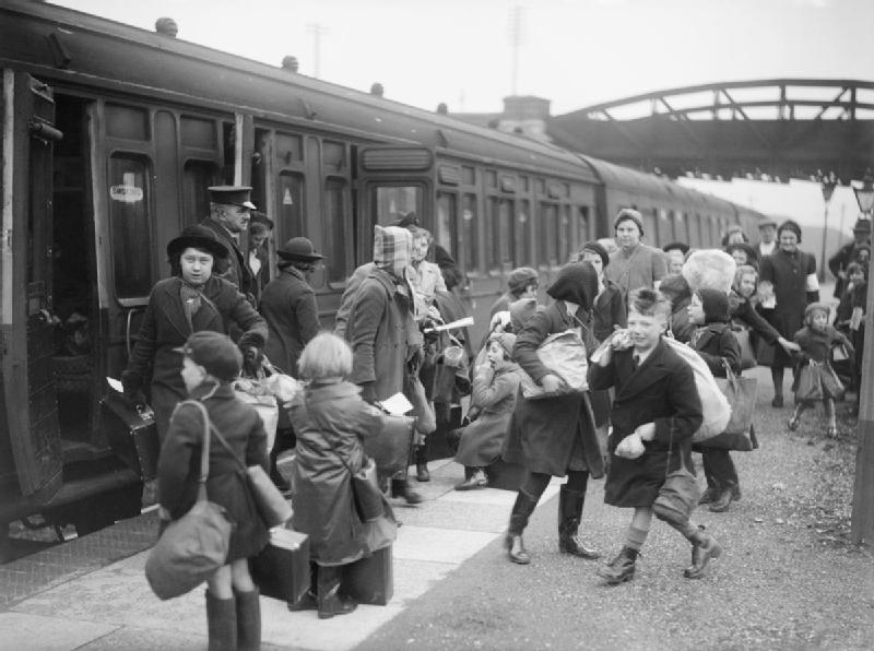 Children being evacuated during world war 2 on a train station platform
