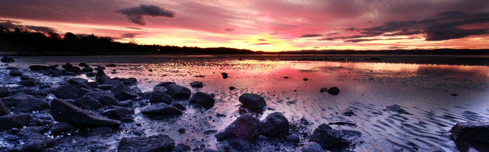 Sun setting on a beach near Edinburgh