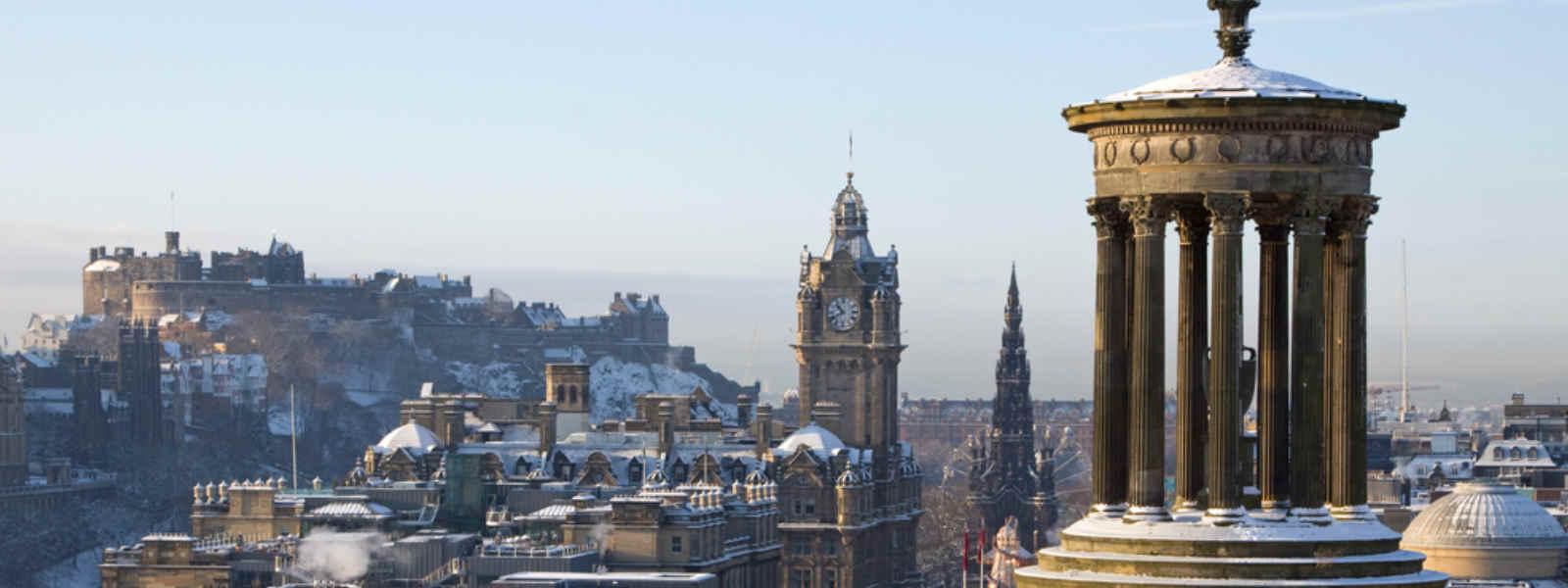 Edinburgh skyline covered in snow seen from Calton Hill