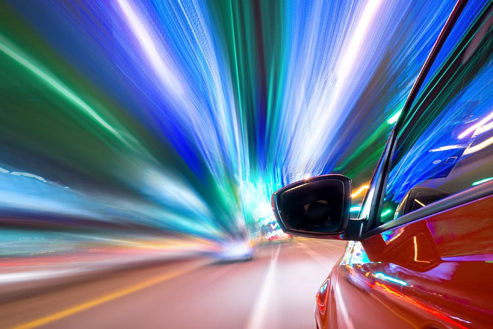 Car speeding through tunnel
