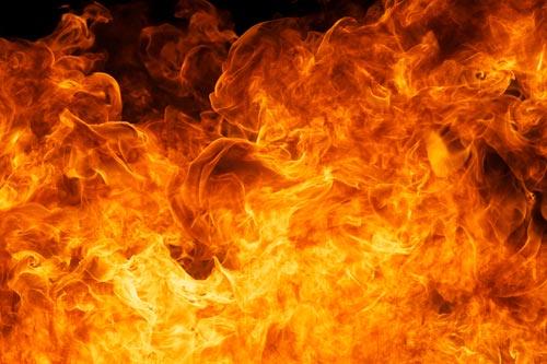 Bright orange flames against a black background