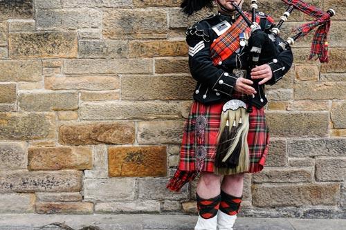 Scottish Bagpiper wearing kilt
