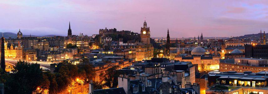The city of Edinburgh lit up at dusk