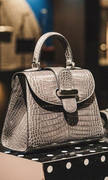 A luxury handbag on display in a shop