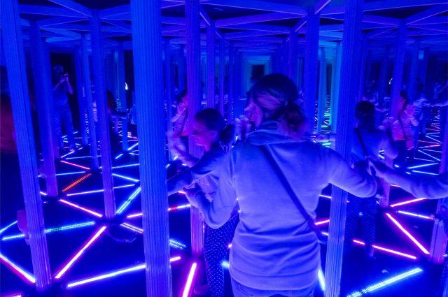 People in a mirrored maze in Camera Obscura Edinburgh