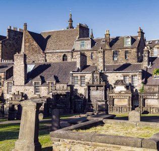 Buildings overlooking the graves and graveyard in Greyfriars Kirkyard
