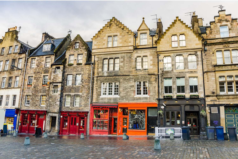 Colourful shop fronts in the Grassmarket in Edinburgh
