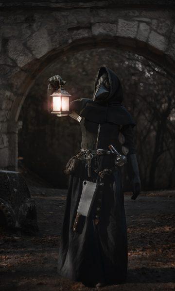 A plague doctor in a darkened underground street