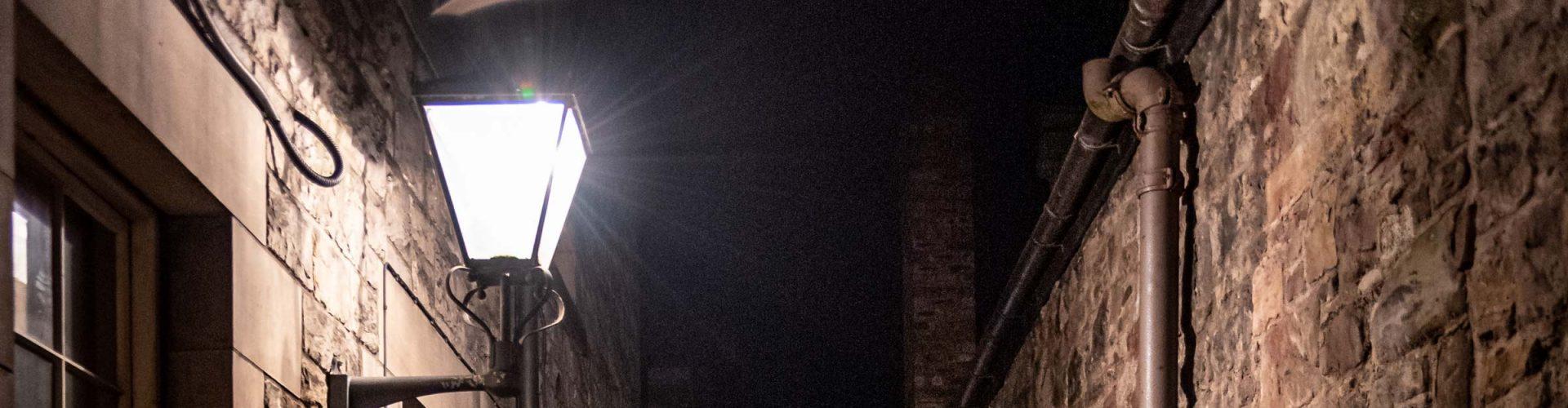 Dark alleyway in Edinburgh with lantern