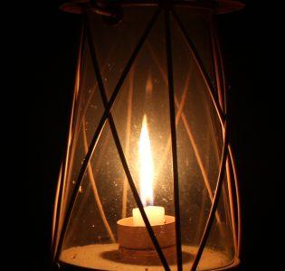 Old lantern burning in dark room