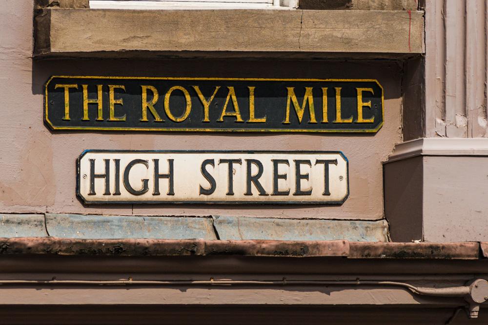 Street signs on the Royal Mile in Edinburgh