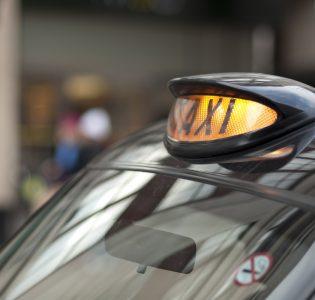 Close up of black cab yellow light