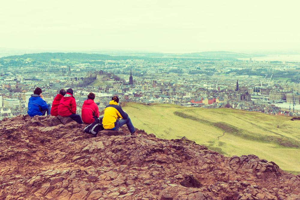 Walker's sitting on the top of Arthur's Seat looking over Edinburgh