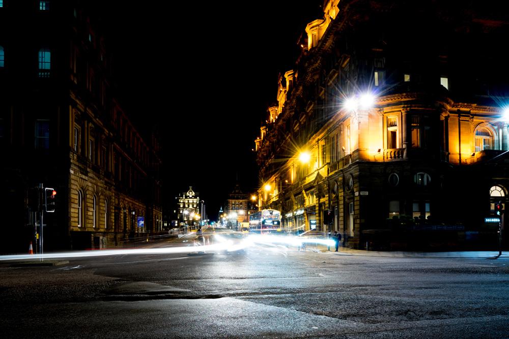 Pitch black sky over Edinburgh street at night