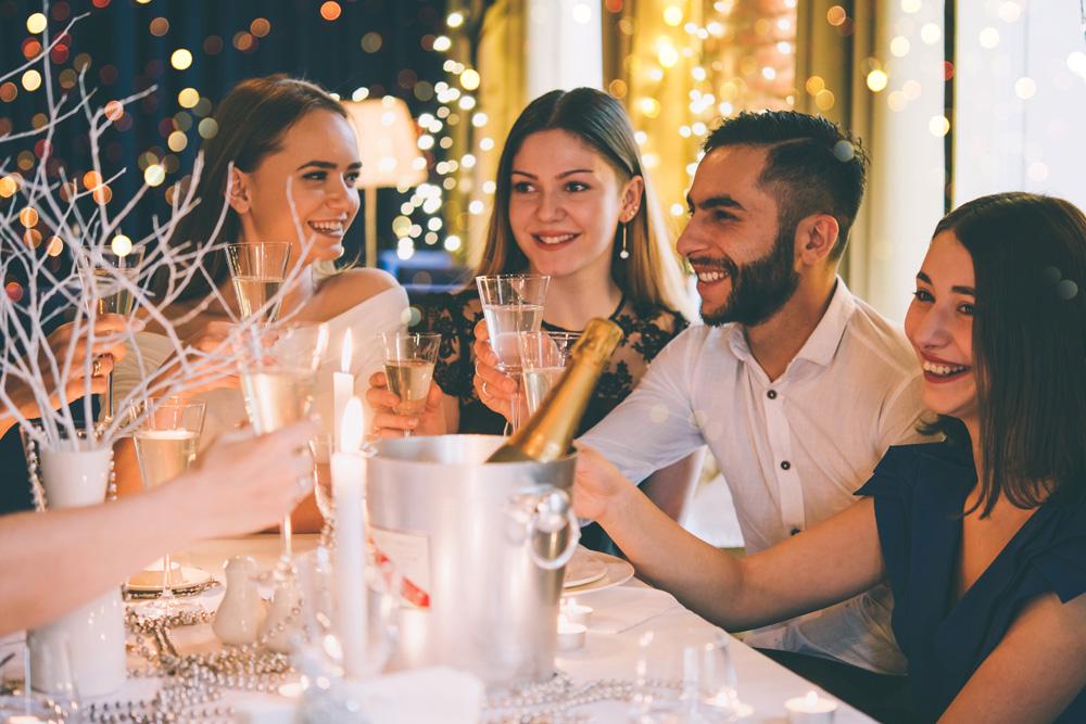 Friends enjoying Christmas dinner at a restaurant