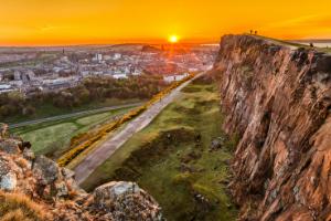 Sun setting over Arthurs Seat and Edinburgh