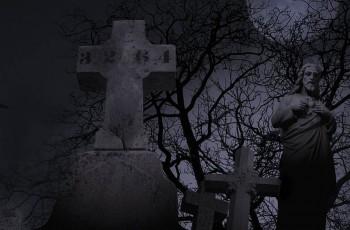 Spooky graveyard at night