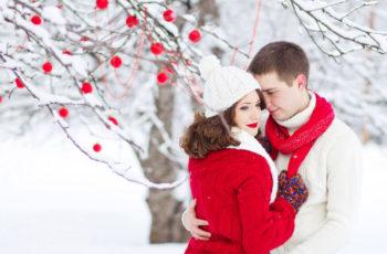 Couple in a winter snowy garden