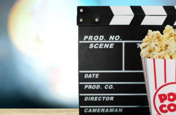 Movie director board and popcorn
