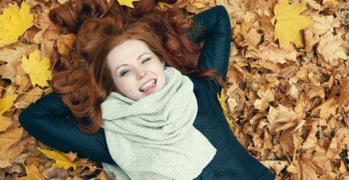 Girl lying in field of leaves