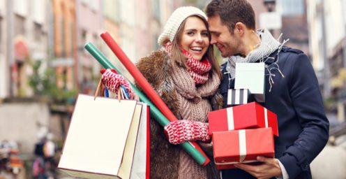 Young couple enjoying Christmas shopping in Edinburgh