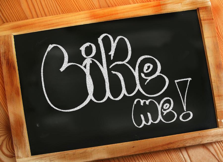 Chalk board with Like Me written on it in chalk.