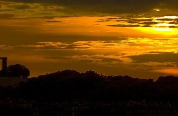 A silhouette of Calton Hill