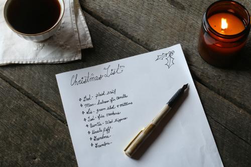 Hand-written Christmas shopping list with pen
