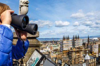 Tourist with binoculars sightseeing in Edinburgh
