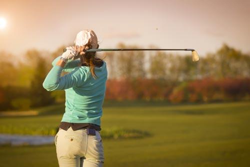 Female golfer playing a shot
