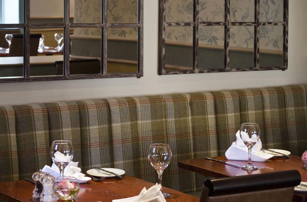 Restaurant tables set for dinner