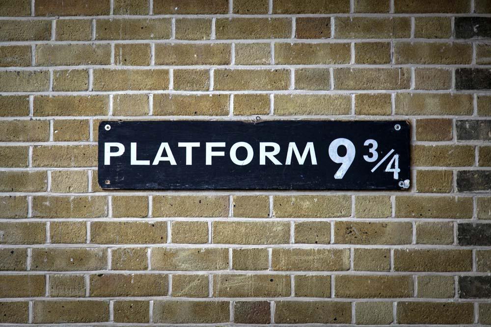 Platform 9 and three quarters sign on statiom wa;ll