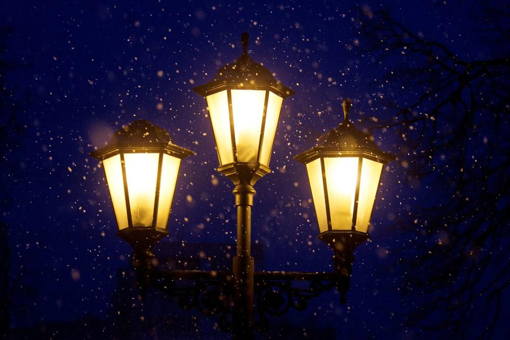 Three street lanterns in the snow