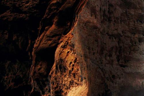 Dark walls of an underground cave