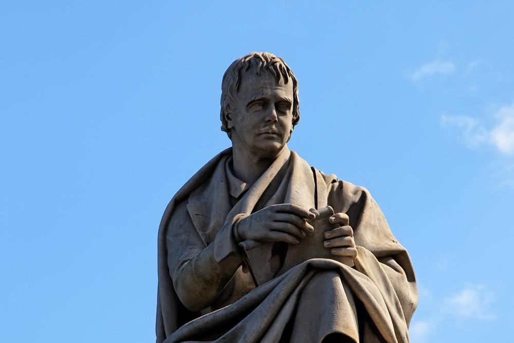 Statue of Walter Scott beneath Scott Monument on Princes Street in Edinburgh