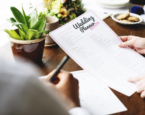 A wedding checklist and pen