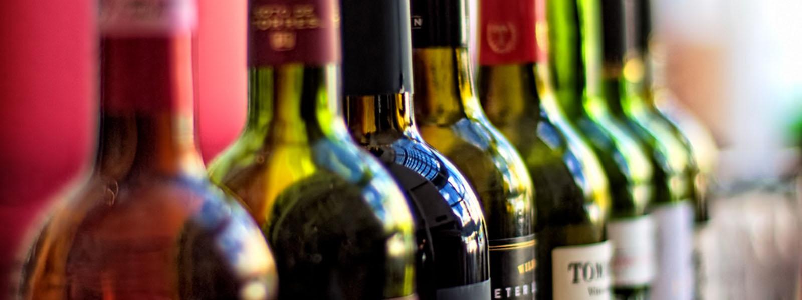 Wine bottles lined up